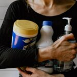 woman holding disinfectant