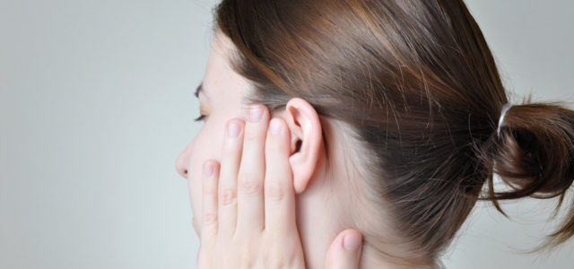 clogged ears remedy woman pain